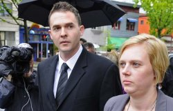 Peter Hodson, the former Vancouver Police officer convicted of drug trafficking, leaves his sentencing hearing with his wife and supporters at Vancouver Provincial Court in Vancouver June 2, 2011. (Photograph by: Les Bazso, PNG)