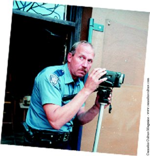 Police surveilance is everywhere, but so are we. photo Chuck Foto