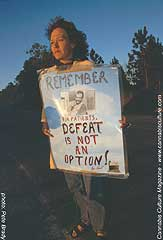 Protestor: `Defeat is not an option.`