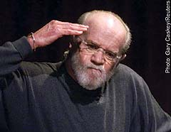 George Carlin: saluting the benefits of a big joint.
