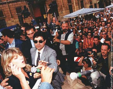 Rita Benardim:about to be arrested for tossing joints to the crowd: Oct 97