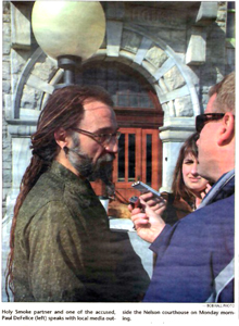 Newspaper photo of Paul DeFelice outside court